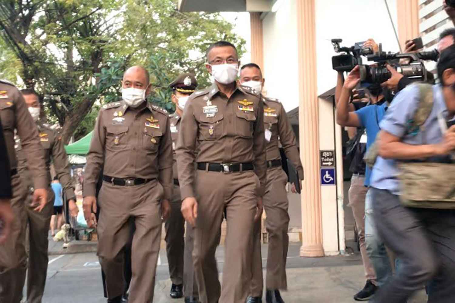 National police chief Pol Gen Suwat Jangyodsuk (front, centre) is at Wat Phraya Krai police station in Bangkok on Tuesday to question suspected traffickers of