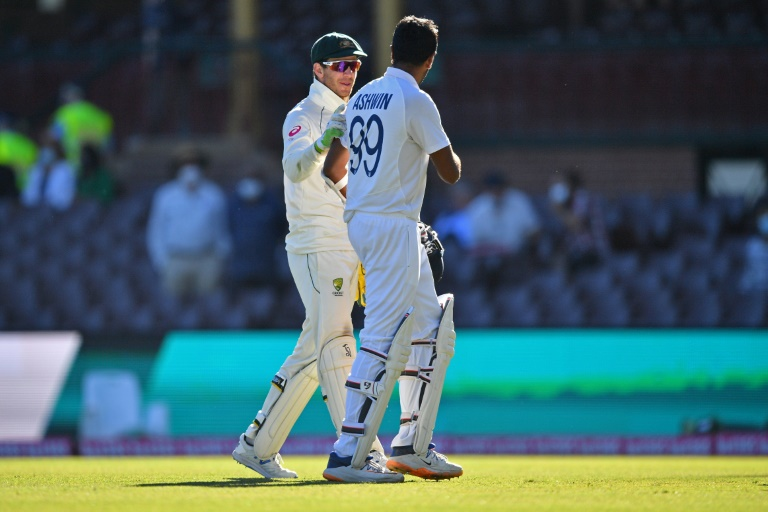 Aussie captain Tim Paine (left) dropped three catches during the epic final day of the third Test, including a chance from India's Ravi Ashwin.