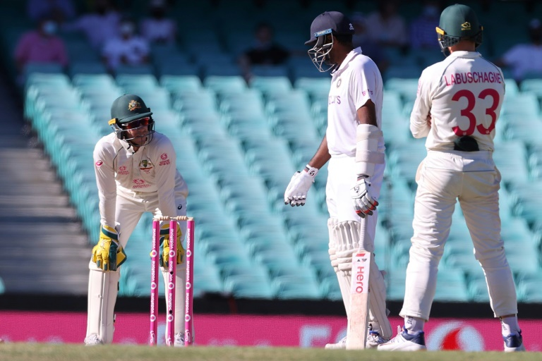 India's Ravichandran Ashwin (centre) has words with Australia captain Tim Paine (left) as Australia's Marnus Labuschagne watches during a tense final day in Sydney.