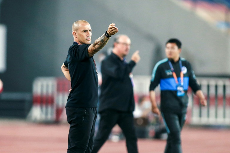 Former World Cup-winner Fabio Cannavaro (left) coaches at Guangzhou Evergrande and former Liverpool manager Rafael Benitez (centre) is in charge at Dalian Pro in the Chinese Super League,