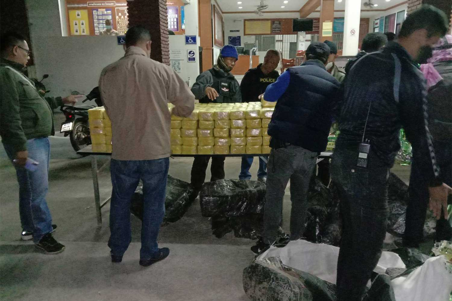 Police display packages containing 2 million speed pills and 400kg of crystal methamphetamine, seized after a shootout with two men in a pickup in Non Daeng district, Nakhon Ratchasima province, in the early hours of Thursday. One suspect was wounded.  (Photo: Prasit Tangprasert)