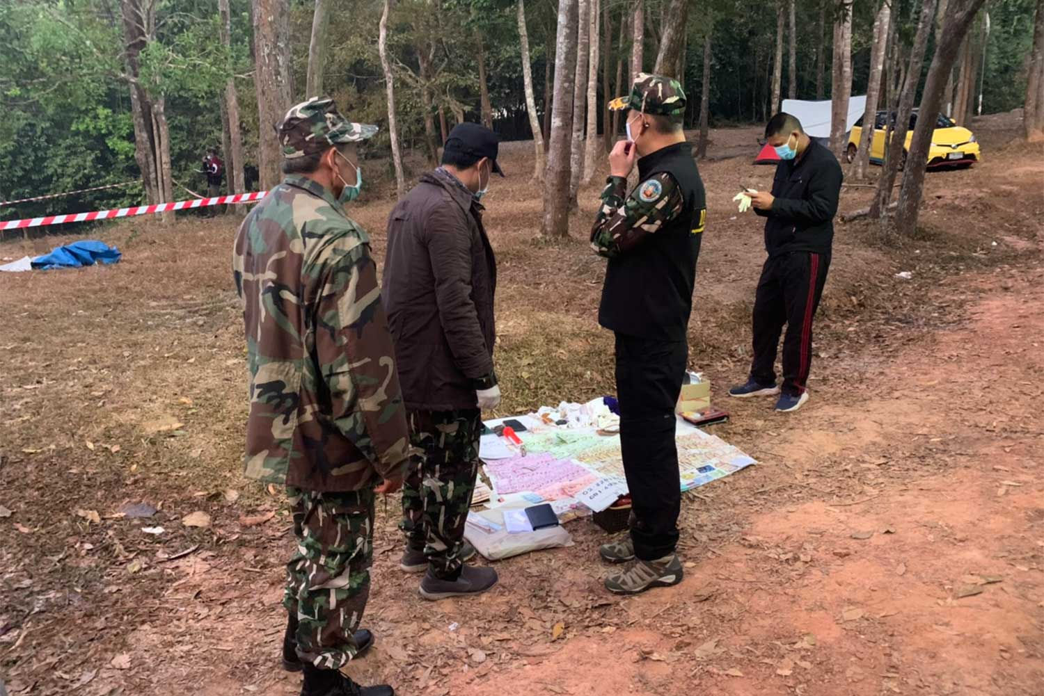 Park officials and police at the scene where a wild elephant killed an elderly man sleeping in a tent, at Pha Kluai Mai camping area in Khao Yai National Park, Pak Chong district, Nakhon Ratchasima, on Friday. (Photo: Supplied/Apinya Wipatayothin)