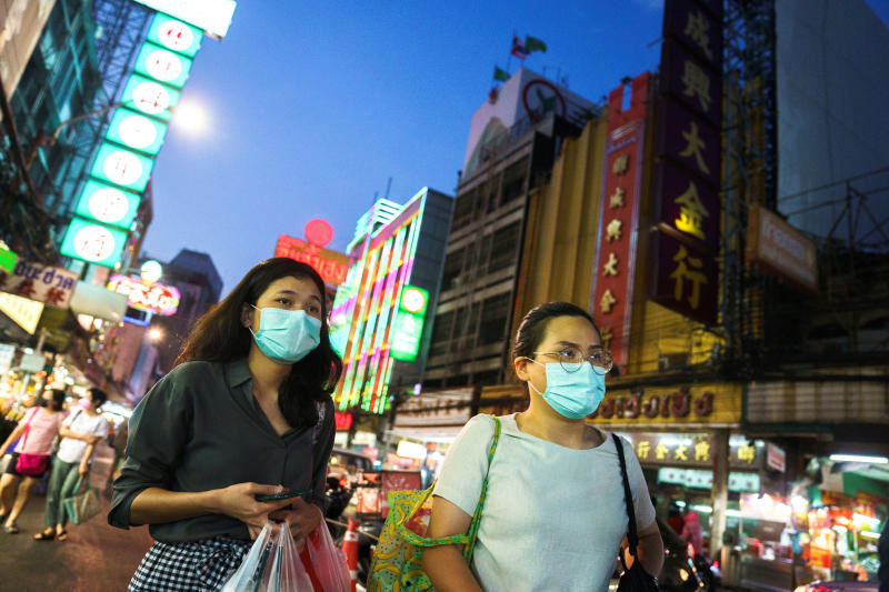 People wearing face masks shop for street food in Yaowarat on Jan 6, amid the spread of the coronavirus disease in Thailand. (Reuters photo)
