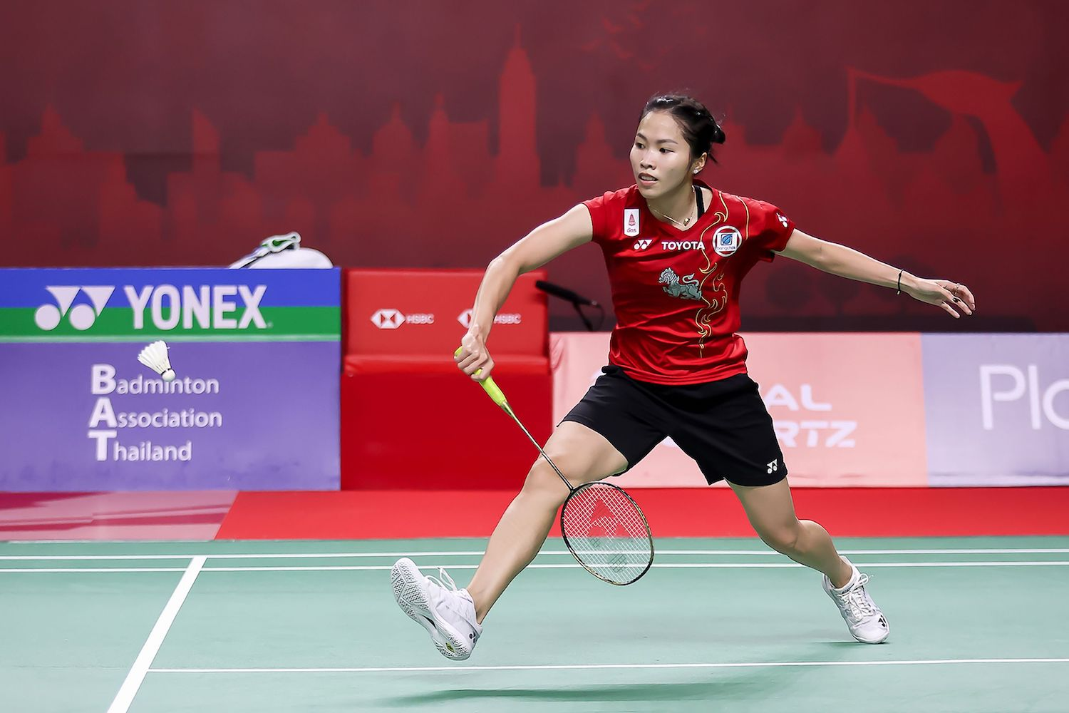 Ratchanok Intanon plays a shot during her second-round match against Germany's Yvonne Li at the Thailand Open in Bangkok on Thursday. Her run at the event ended on Friday with a loss to An Se-young of South Korea. (Badminton Association of Thailand via AFP)