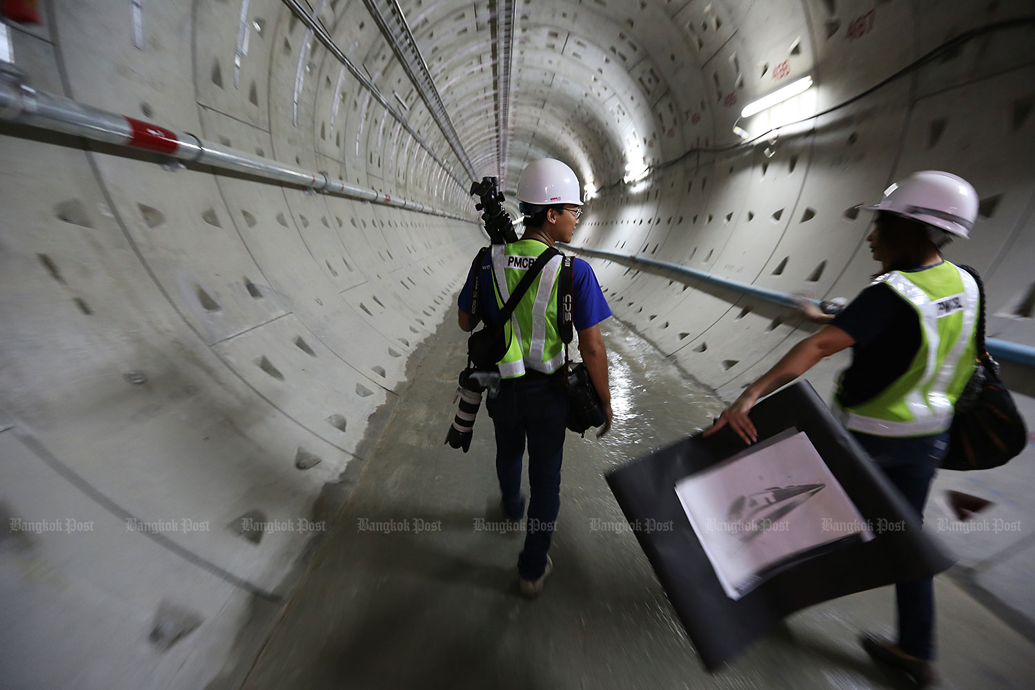 Tubing the river: Engineers inspect a 200-metre tunnel underneath the Chao Phraya River. Part of the 27-kilometre Blue Line extension from Hua Lamphong to Bang Khae, the project was Thailand's first river tunnel. (Bangkok Post file photo)