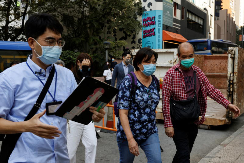 Tourists wearing face masks walk with a tour guide during a Hong Kong Tourism Board's free local tour on Nov 1, 2020. (Reuters photo)