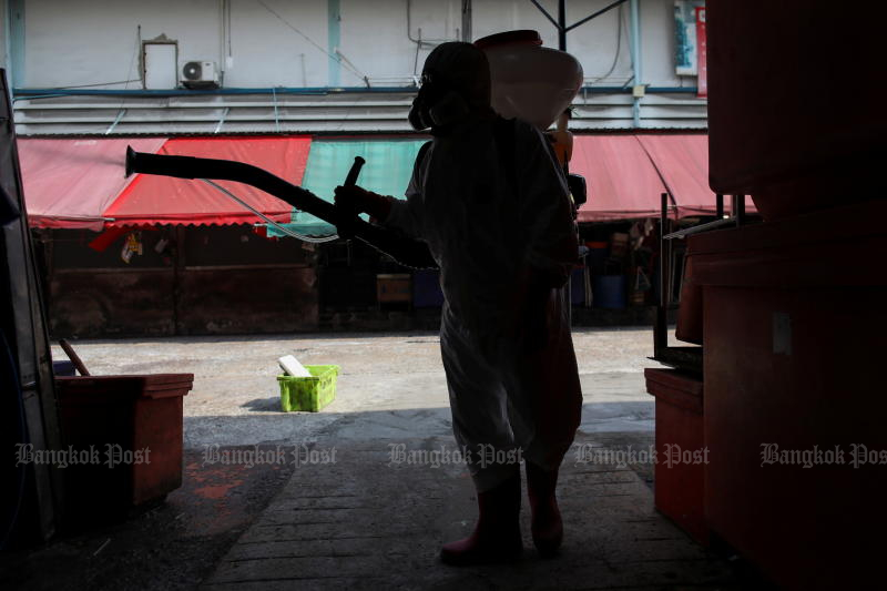 A City Hall worker sprays disinfectant at the Klong Toey fresh market after it was temporarily shut down amid the coronavirus disease outbreak in Bangkok on Friday. (Reuters photo)