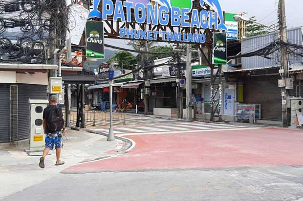 Patong beach in Phuket, usually packed with tourists, is virtually deserted as the island feels the harsh impact of the pandemic.(Photo by Apinya Wipatayotin)
