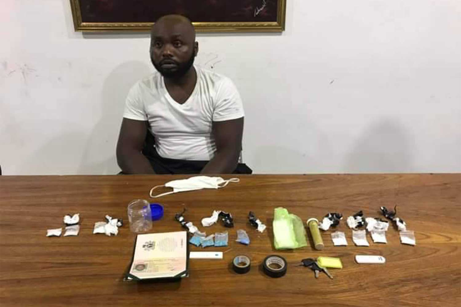 Davidsmith Chinazaekpere Ejiogo, 26, a Nigerian national, at Patong police station after his arrest with small amounts of crystal methamphetamine, cocaine and ecstasy in his pockets, in Patong area, Phuket. (Photo: Achadtaya Chuenniran)