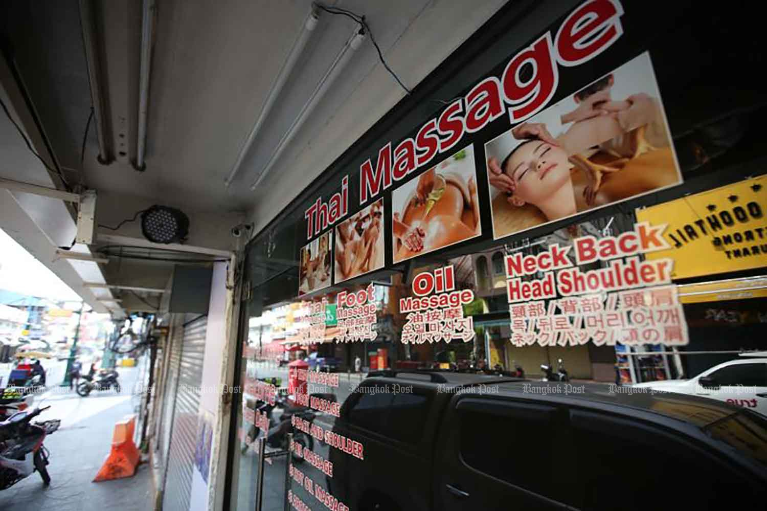 This traditional Thai massage parlour on Khao San Road was closed on Thursday, but is among 13 kinds of premises allowed to reopen in the capital on Friday. (Photo: Pattarapong Chatpattarasill)