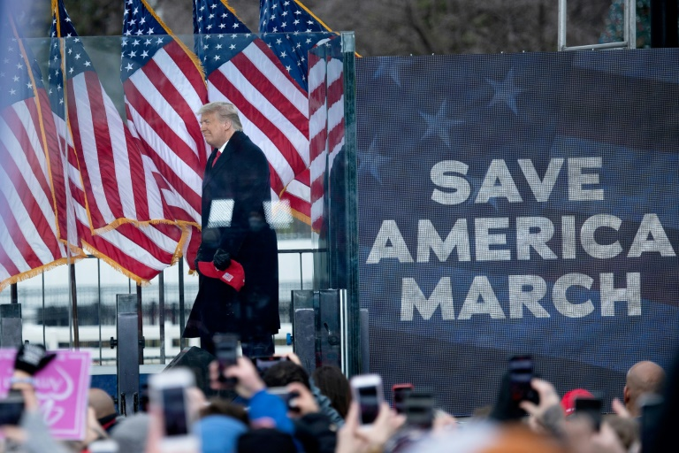 Donald Trump is seen addressing supporters flooding the nation's capital ahead of the insurrection at the US Capitol on Jan 6, 2021.