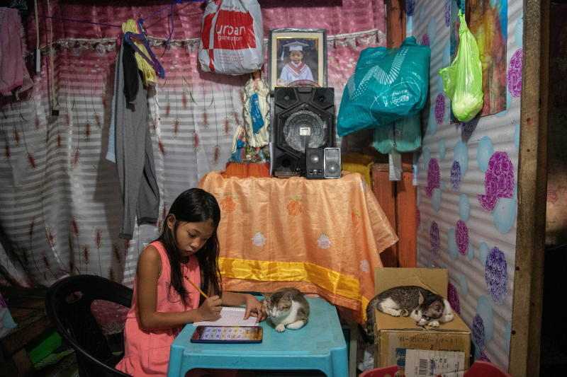 Nhieshalyn Galicia, 8, a grade 2 student, works on a school assignment at her home, as schools remain closed during the coronavirus disease (Covid-19) outbreak, in Manila, Philippines, Jan 6, 2021. (Reuters file photo)