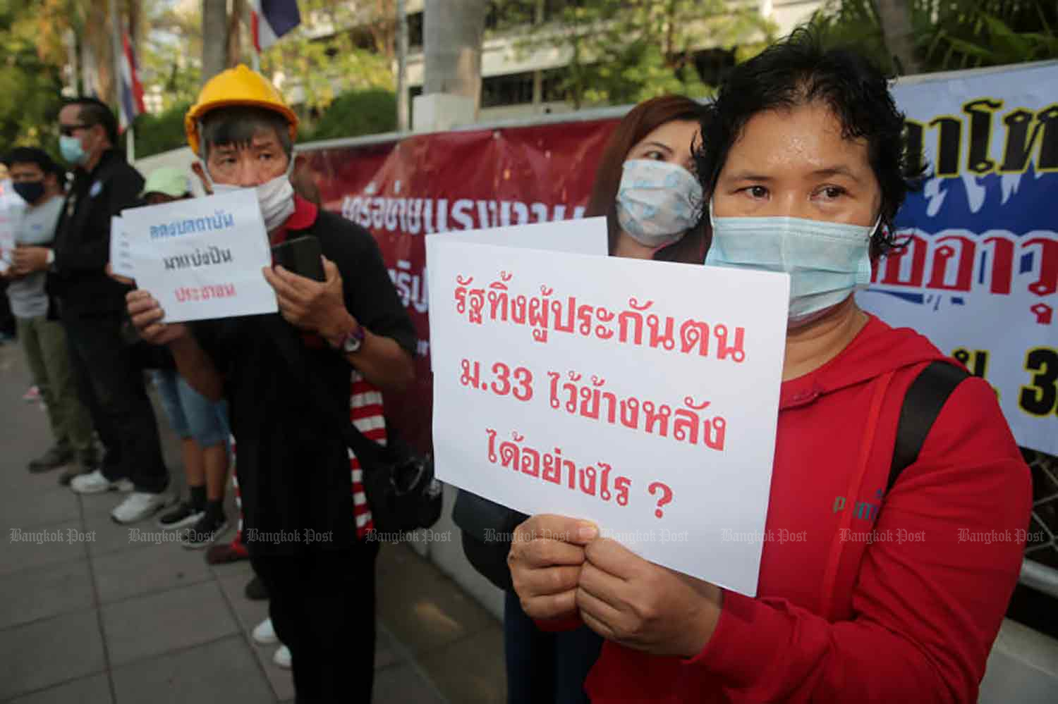 Labour activists gather at Government House in Bangkok on Tuesday to seek financial aid for workers in the Social Security system. (Photo by Chanat Katanyu)