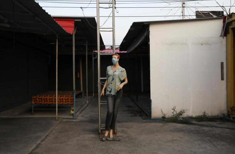 A mannequin stands in isolation outside a closed shop at the shutdown Samut Sakhon Shrimp Market on Wednesday, as Thailand's economy struggles to surface from the year-long impact of the Covid-19 pandemic. (Photo: Reuters)