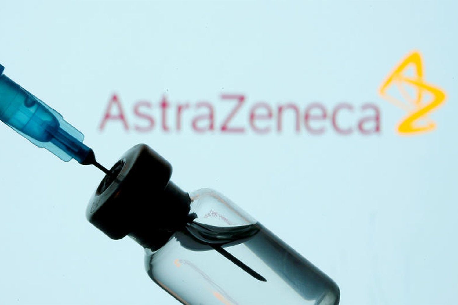 A vial and sryinge are seen in front of a displayed AstraZeneca logo on Jan 11, 2021. (Reuters photo)