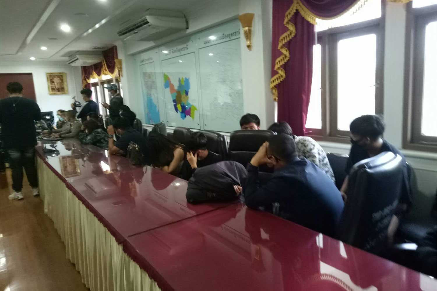 Twenty-two people are arrested during a pre-dawn raid on a hotel room in Udon Thani province with some illicit drugs seized. (Photo taken from Muang Udon Thani police Facebook page)