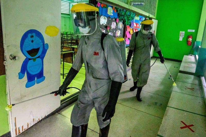 Thai soldiers wearing personal protective equipment (PPE) disinfect a school to combat the spread of the Covid-19 coronavirus in Bangkok on Jan 28, 2021, ahead of the school reopening on Monday. (AFP photo)