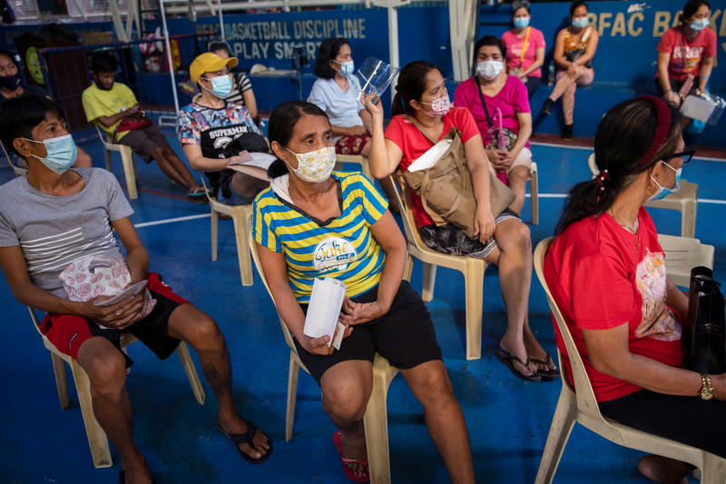 Gemma Roxas, 57, wearing a protective mask for protection against the coronavirus disease (Covid-19), queues for a general check-up at a local health center in Manila, Philippines Jan 26, 2021. (Reuters file photo)