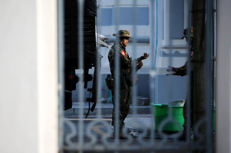 Myanmar soldiers are seen inside City Hall in Yangon on Monday. (Reuters photo)