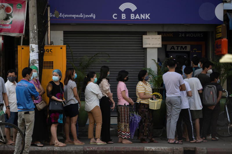 People line up outside a bank branch in Yangon on Monday. (Reuters photo)