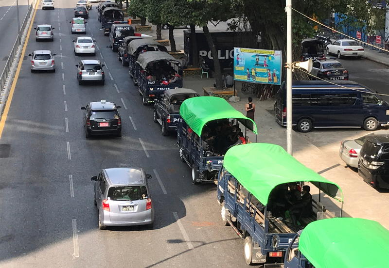 Myanmar police vehicles drive near the City Hall in Yangon on Monday. (Reuters photo)