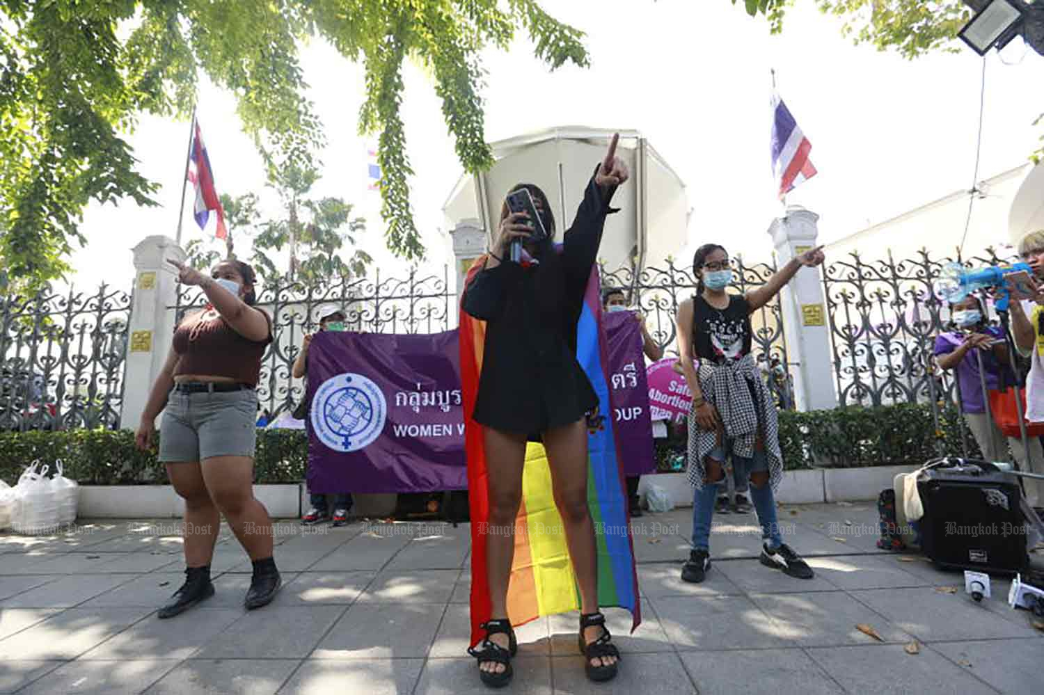 Activists gather at Government House in Bangkok on Monday to demand assistance for Covid-19-affected people, especially women, children and vulnerable people. (Photo: Arnun Chonmahatrakool)