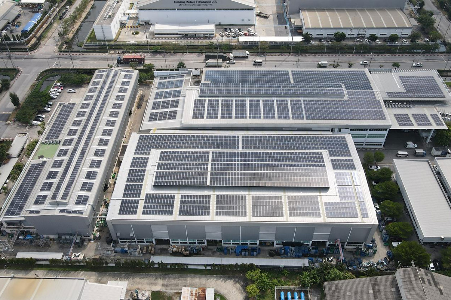 Rooftop solar panels are installed at an industrial site to take advantage of the larger surface areas.