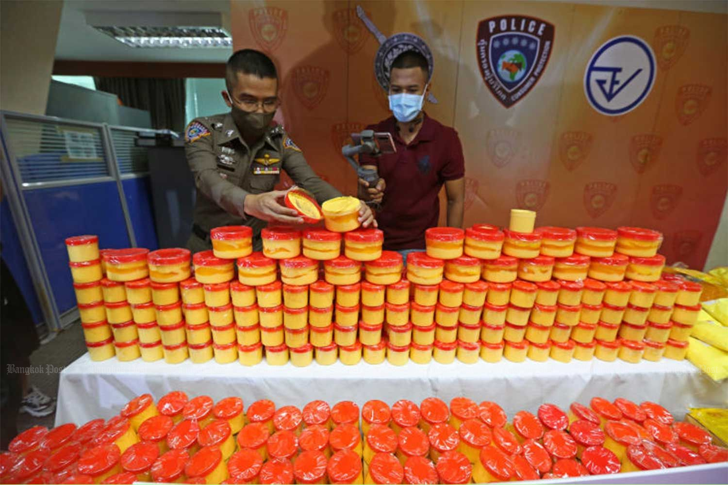 Unregistered whitening cream seized during raids on four factories is on display during a police briefing on Thursday. (Photo by Varuth Hirunyatheb)