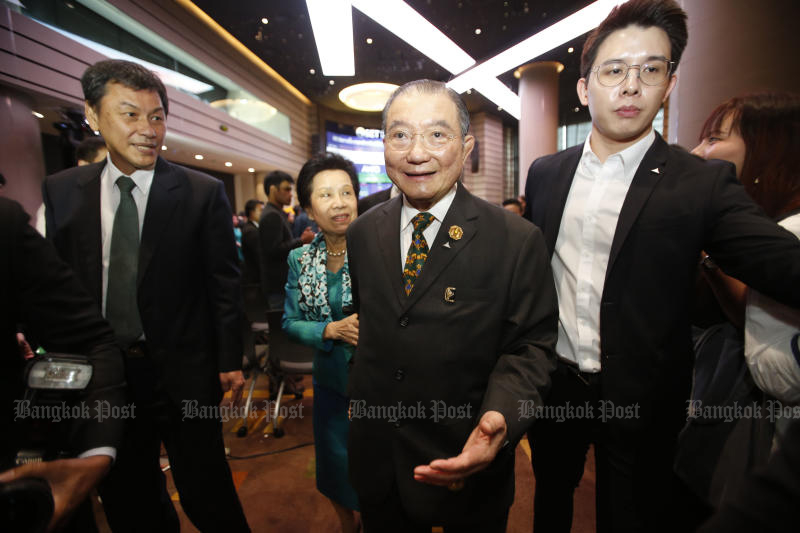 Tycoon Charoen Sirivadhanabhakdi (centre) controls Thai Beverage, one of Southeast Asia's largest drinks makers.