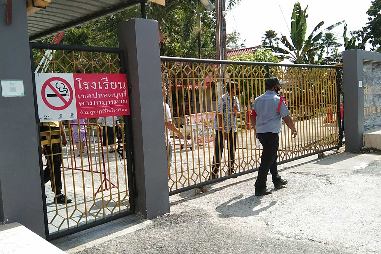 The gates were firmly shut on Friday at the school in Thepha district of Songkhla where the director faces charges of raping a student and carrying a gun during morning assembly. (Photo: Assawin Pakkawan)
