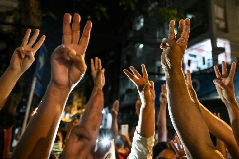People give a three-finger salute in Myanmar as they protest against a military coup that was been denounced by the UN.