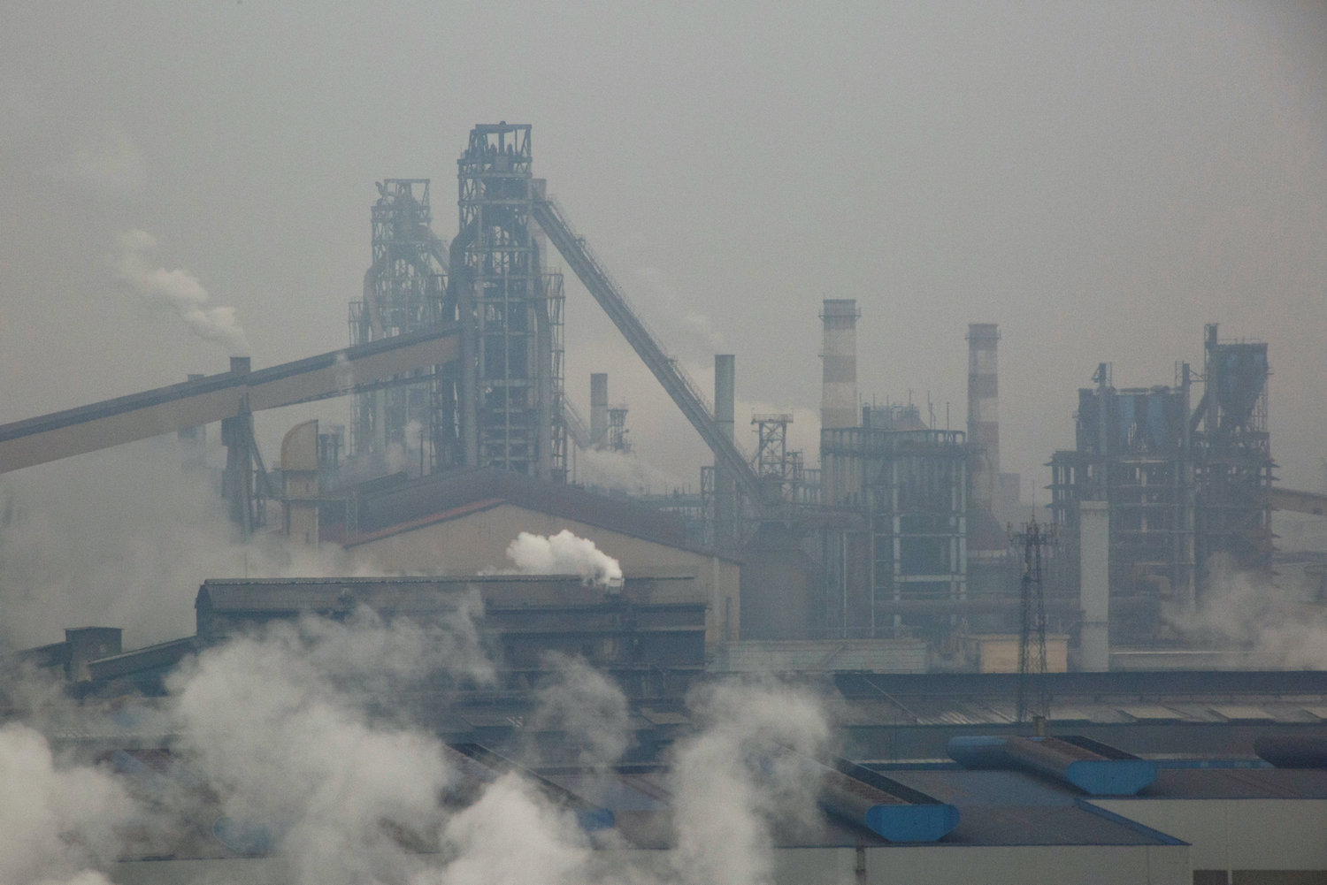 Smoke and steam rise from a steel plant in Anyang in Henan province of China. (Reuters File Photo)