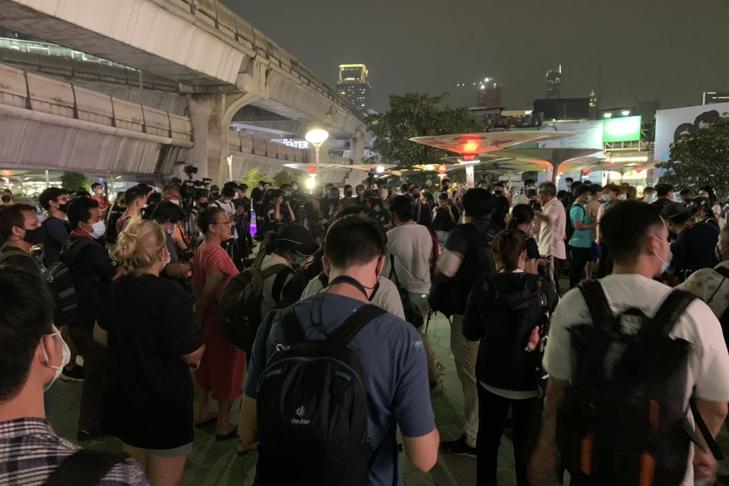 A number of people meet at Pathumwan intersection after news that key Ratsadon protesters were denied bail and detained on lese majeste charges. (Photo from Twitter: Nopkong @SAHINOP)