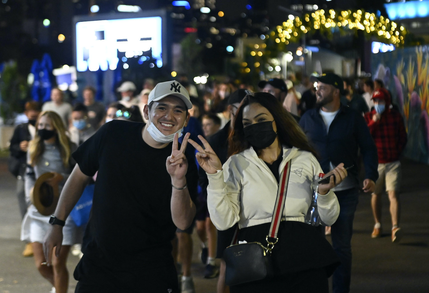 Fans leave the Australian Open on Friday night after Victoria state authorities announced a surprise five-day lockdown following the discovery of a handful of Covid cases at a hotel. (Reuters Photo)