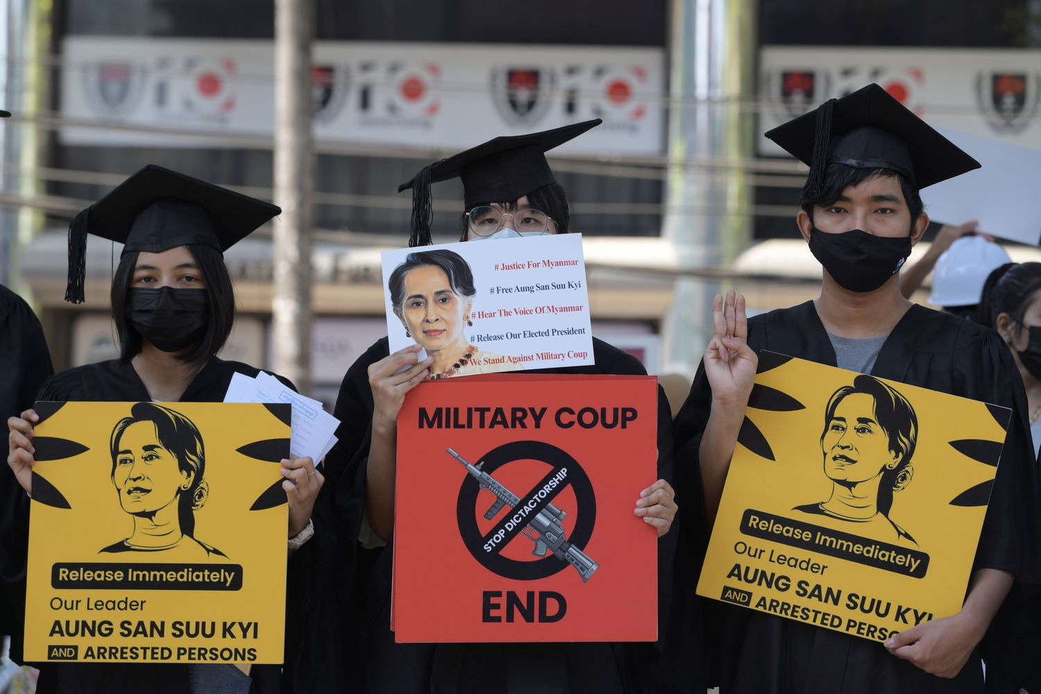 Demonstrators hold signs during a protest against the military coup and demanding the release of elected leader Aung San Suu Kyi, in Yangon on Saturday. (Reuters photo)