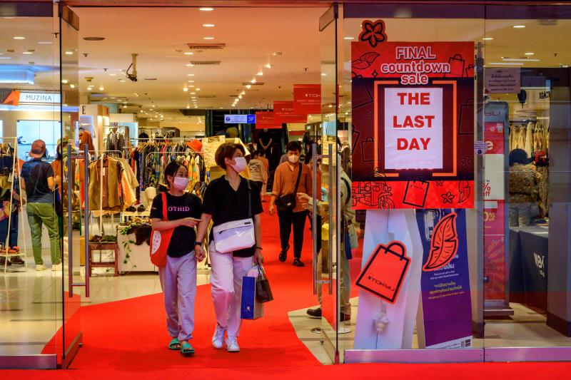 FILE PHOTO: Customers exit Japan's Tokyu Department Store in Bangkok after the company decided to close its Thai operation following a wave of financial difficulties, on Jan 31, 2021. (AFP)