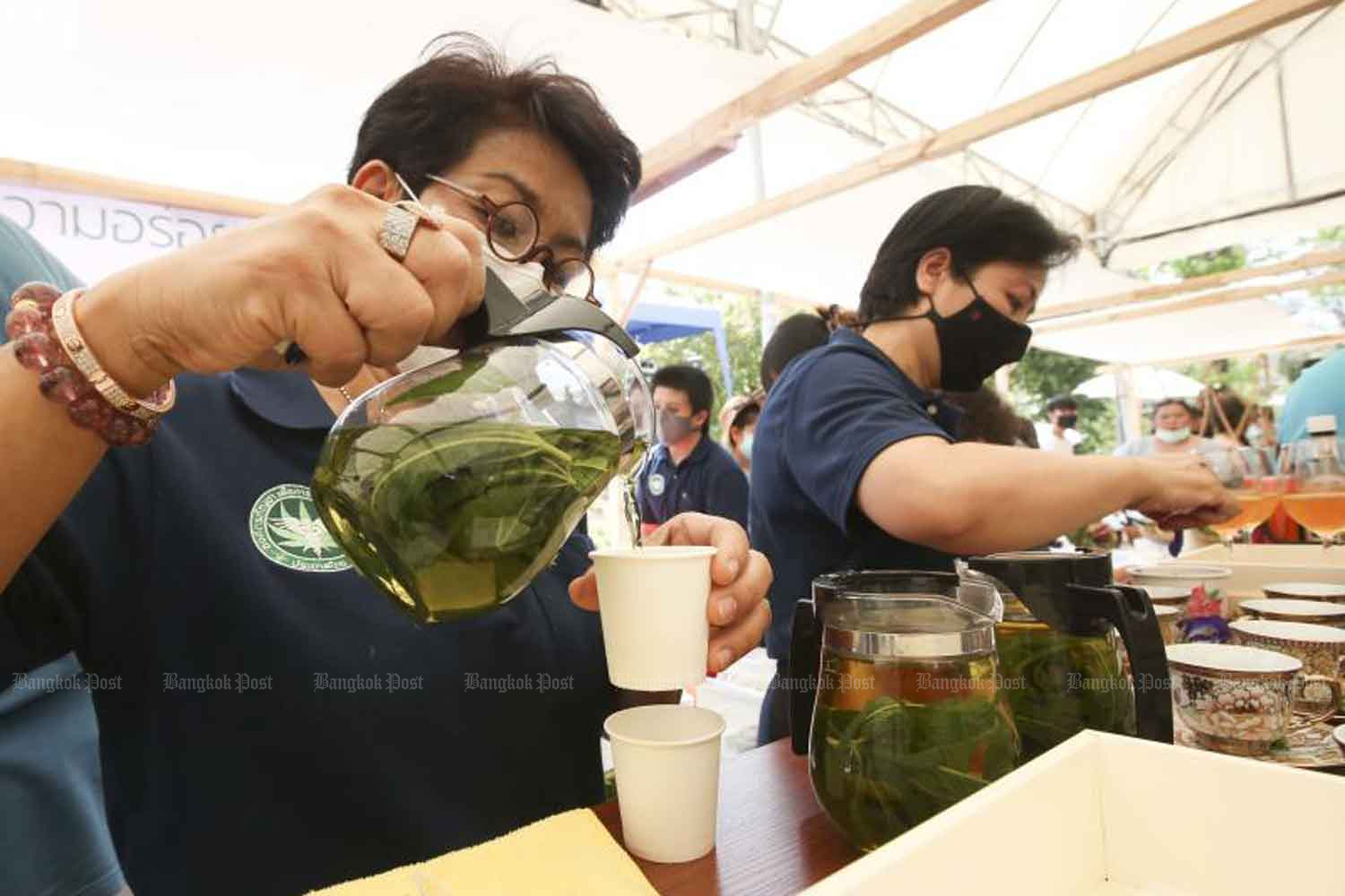 Officials of the Department of Thai Traditional and Alternative Medicine make cannabis tea in a demonstration of legal cannabis use at the Public Health Ministry in Nonthaburi province on Monday. (Photo by Pattarapong Chatpattarasill)