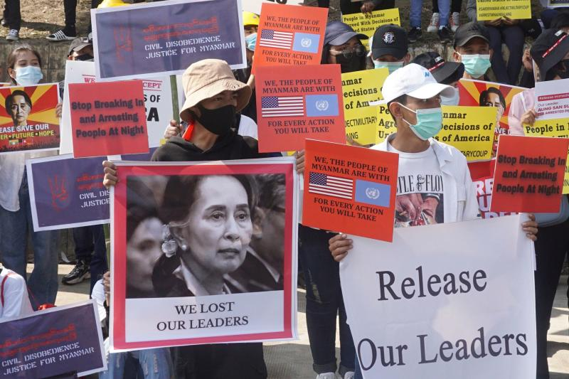 Protesters hold up signs with an image of detained Myanmar leader Aung Saan Suu Kyi and demanding her release during a demonstration against the military coup in front of the US embassy in Yangon on Tuesday. (AFP photo)
