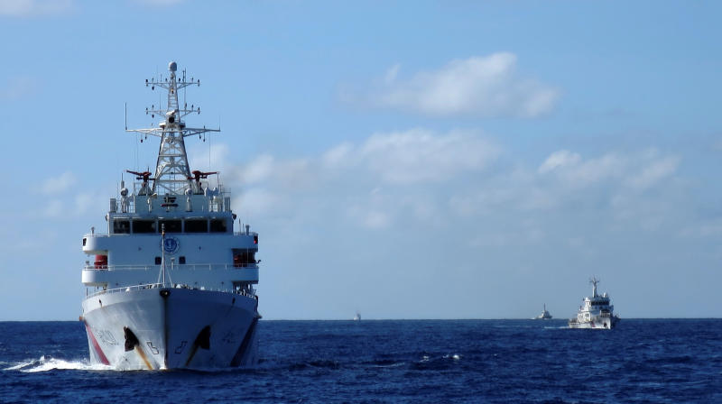 FILE PHOTO: Chinese coastguard ships give chase to Vietnamese coastguard vessels (not pictured) after they came within 10 nautical miles of the Haiyang Shiyou 981, known in Vietnam as HD-981, oil rig in the South China Sea, July 15, 2014. (Reuters)