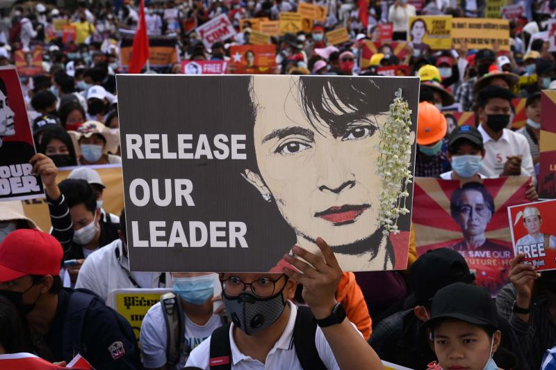 A protester holds a sign calling for the release of detained Myanmar civilian leader Aung San Suu Kyi as they block a road during a demonstration against the military coup in Yangon on Wednesday. (AFP photo)
