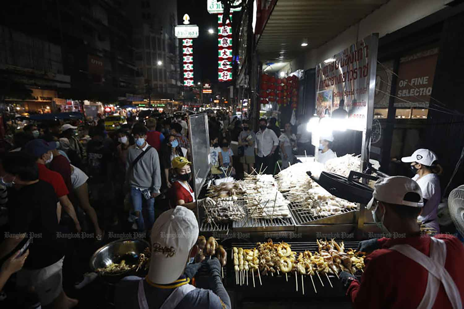 Bangkok's Chinatown is lively at night with visitors and street food vendors. Authorities plan to ease restrictions on business and other activities in more provinces as the overall Covid-19 situation has improved. (Photo: Wichan Charoenkiatpakul)
