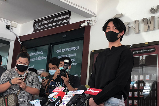 Techin Ploypetch, aka DJ Matoom, answers questions after reporting to Thung Mahamek police on Friday. He was soon after given a suspended jail sentence by the court. (Photo: Wassayos Ngamkham)