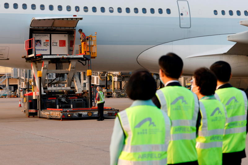 Containers carrying Sinovac Biotech coronavirus disease vaccines are unloaded from a Cathay Pacific Airways aircraft at Hong Kong International Airport on Friday. (Reuters photo)