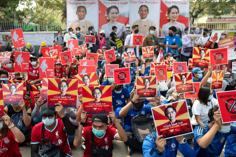Demonstrators protest against the military coup in Yangon on Sunday. A rally was held in Tachilek, across the border from Mae Sai district of Chiang Rai, the same day. (Reuters photo)