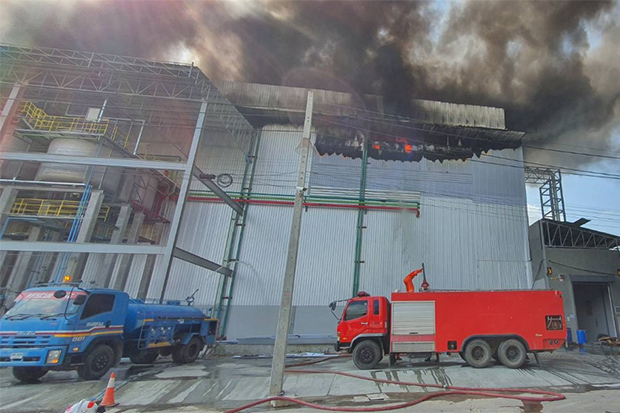 A fire is seen at a factory Sri Trang Gloves (Thailand) in Kanchanadit district of Surat Thani on Sunday. (Photo by Supapong Chaolan)