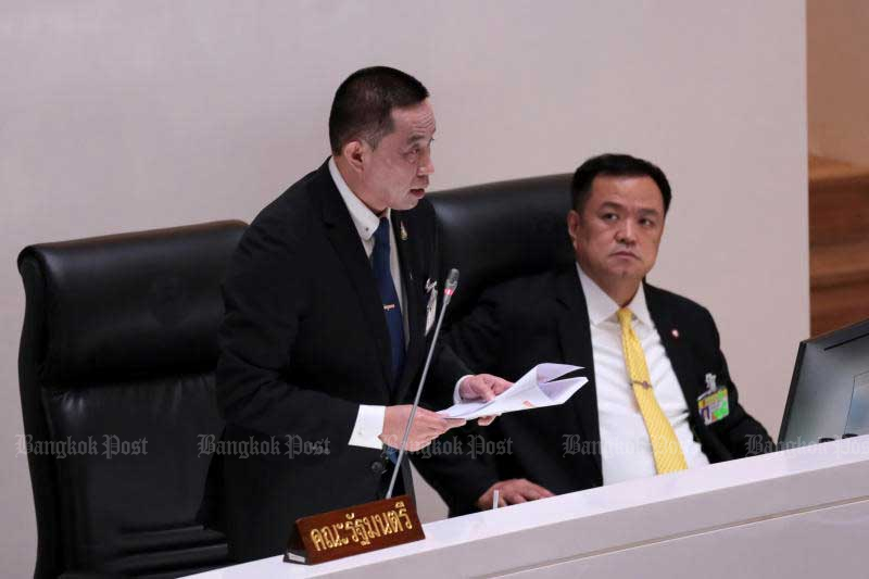 Transport Minister Saksayam Chidchob speaks as Public Health Minister Anutin Charnvirakul looks on during the censure debate in Parliament. (Photo by Chanat Katanyu)