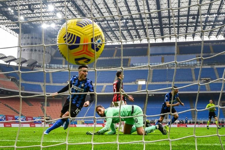Inter Milan's Argentine forward Lautaro Martinez (L) celebrates after his second goal against AC Milan.
