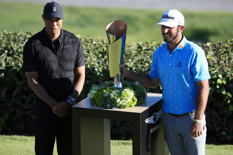 Tiger Woods, a 15-time major winner at left with 2021 PGA Genesis Invitational winner Max Homa, said Sunday he wants to play in April's Masters but isn't sure his surgically repaired back will be ready by then