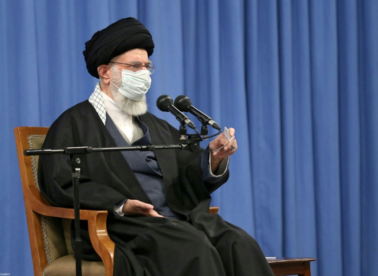 A handout picture provided by the office of Iran's Supreme Leader Ayatollah Ali Khamenei on February 21, 2021 shows him meeting with members of the Iranian Assembly of Experts in the capital Tehran