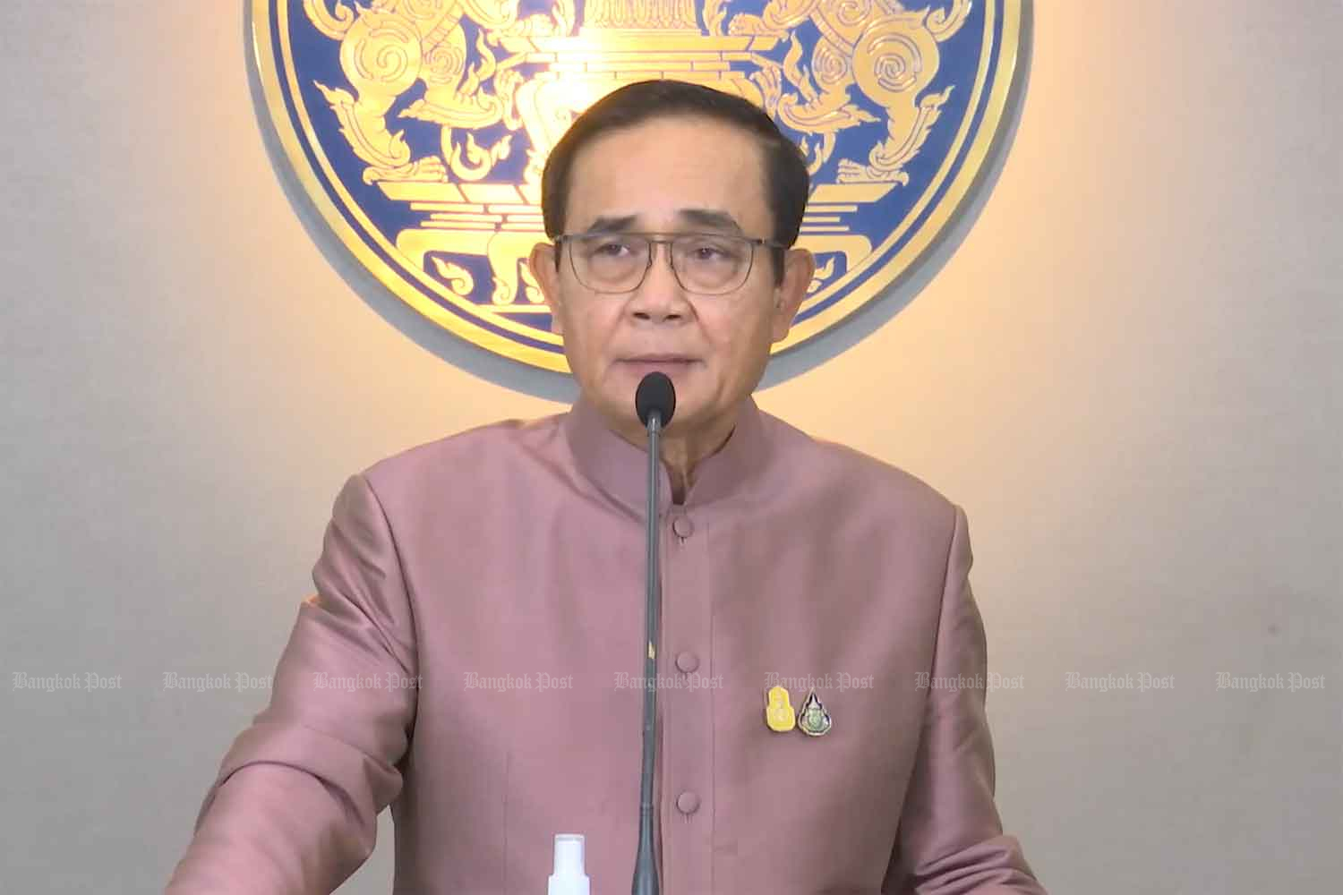Prime Minister Prayut Chan-o-cha speaks to reporters after the cabinet's meeting at Government House on Tuesday. (Screenshot)